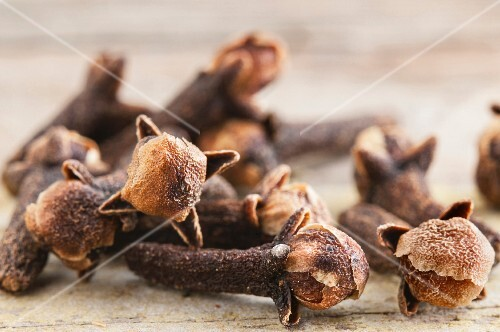Close Up of Cloves on a White Background