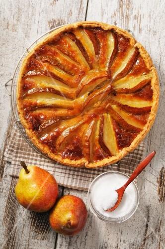 Pear tart, sugar and fresh pears