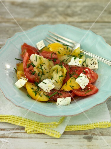 Tomato salad with feta cheese and chives