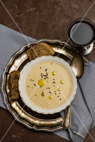 Cheese soup with olive oil and black caraway