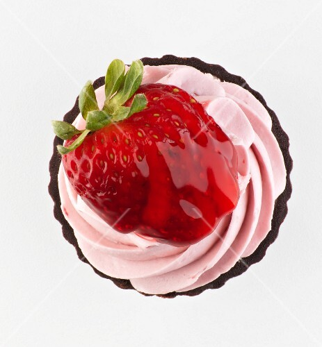 A strawberry cupcake seen from above