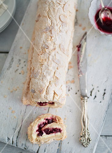 A cranberry roulade, sliced