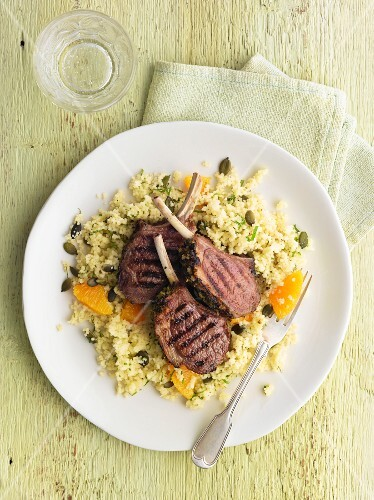 Two Lamb Chops on a Plate with Couscous