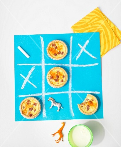 Mini cheese and ham tartlets as a snack for children