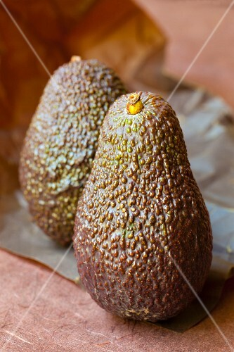 Two avocados on a piece of paper