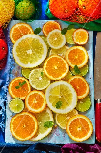 Citrus fruit slices on a wooden board
