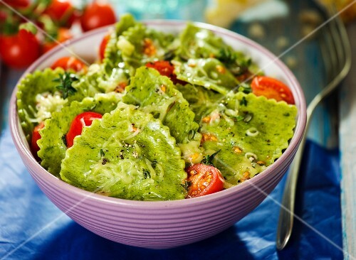 Green ravioli with tomatoes