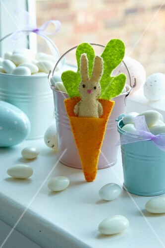 Hand-crafted, felt rabbit in felt carrot as Easter decoration
