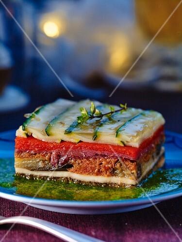 A layered vegetable, mozzarella and bresaola bake