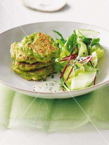 Pea and mint cakes with a mixed leaf salad