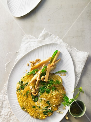 A green omelette with fried asparagus and mange tout