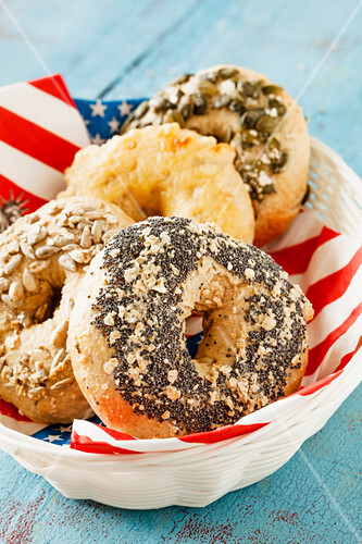 Bagels in a bread basket with a USA cloth