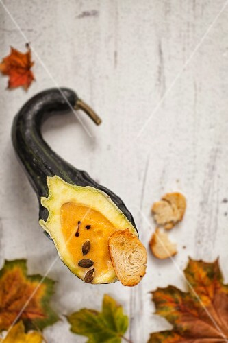 Autumnal pumpkin soup served in a hollowed-out pumpkin
