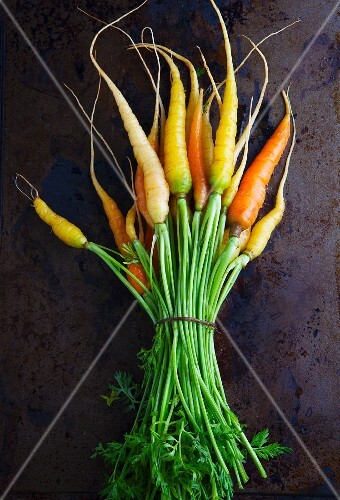 A bundle of various carrots