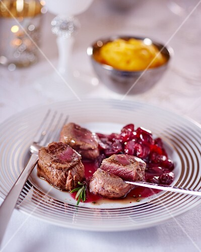 Venison medallions with cranberry sauce for Christmas