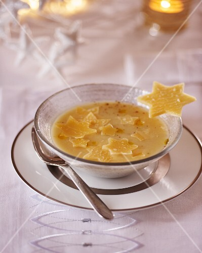 Cream of cheese soup with Parmesan stars for Christmas