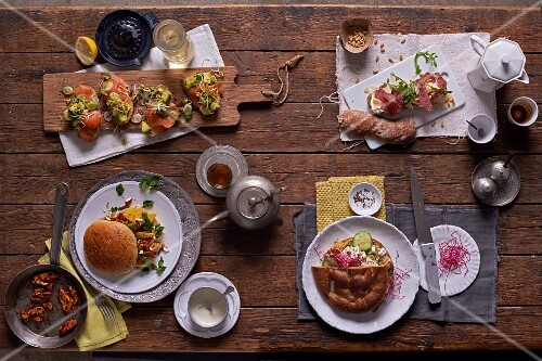 Avocado and salmon crostini; rye bread roll with tandoori chicken and mango; a salami sandwich with Parmesan and pine nuts, and unleavened bread with hummus and sheep's cheese