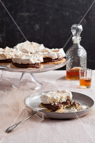 Sweet pastries with chocolate cream and meringue