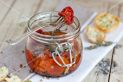A marinade made with dried tomatoes, olive oil and rosemary