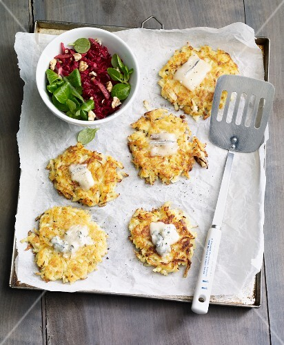Mini fried potato cakes with pears served with a beetroot salad