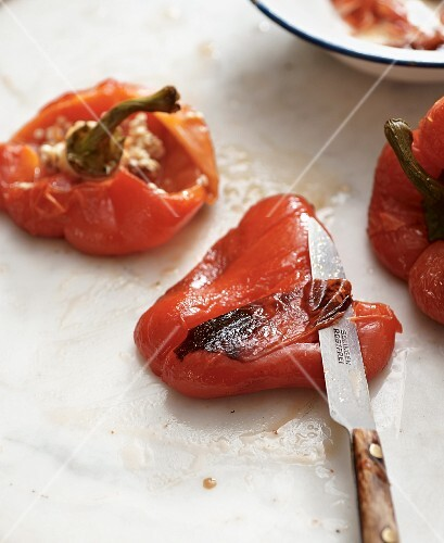 Grilled peppers being skinned