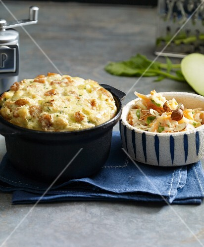 Potato souffle with crabs served with coleslaw