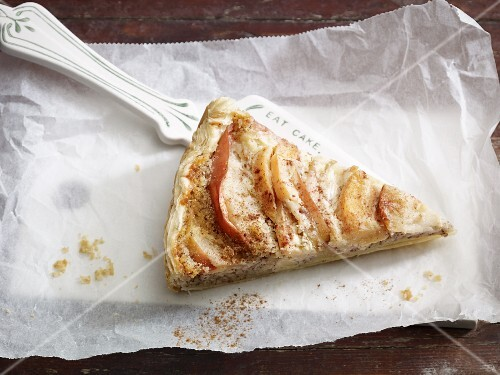 A slice of apple and quince tart on a cake slice