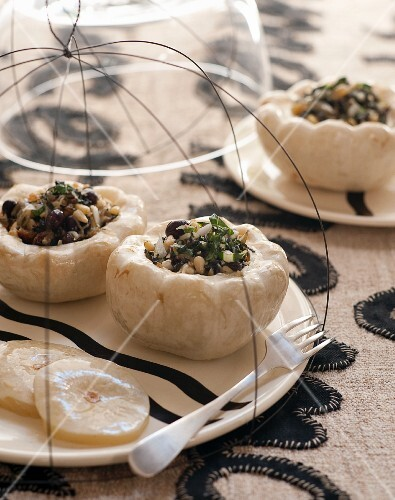 White pattypan squash filled with pine nuts, olives and basil