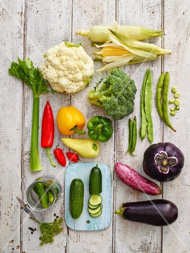 Various types of summer vegetables on a wooden surface