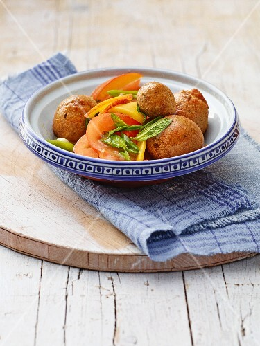 Falafel with a tomato and peach salad
