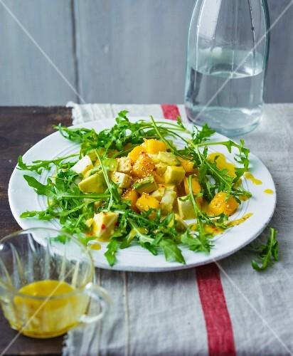 Fruit mango and mozzarella salad with avocado