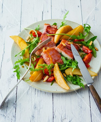 Goat's cheese wrapped in ham with pear wedges and rocket