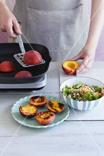 Peaches being grilled to be served with a barley salad