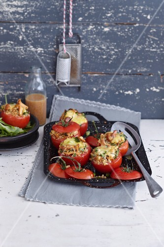 Oven-roasted tomatoes filled with chanterelle mushrooms and bulgur wheat