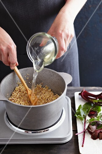 Steamed pearl barley being quenched with wine