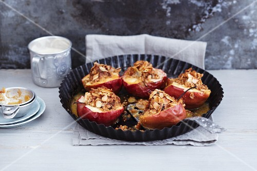Baked apples with a quinoa and marzipan filling and flaked almonds