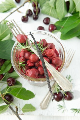 Preserved cherries with rosemary and vanilla pods