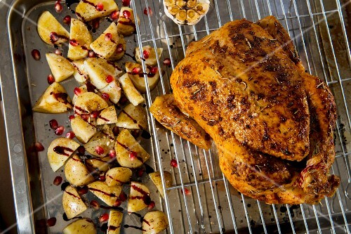 Roast chicken with balsamic potatoes and pomegranate seeds