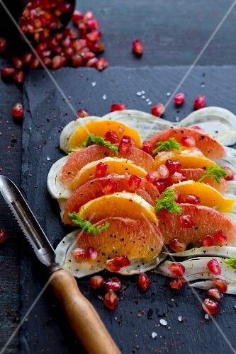Fennel and grapefruit salad with orange segments, pomegranate seeds and fennel leaves