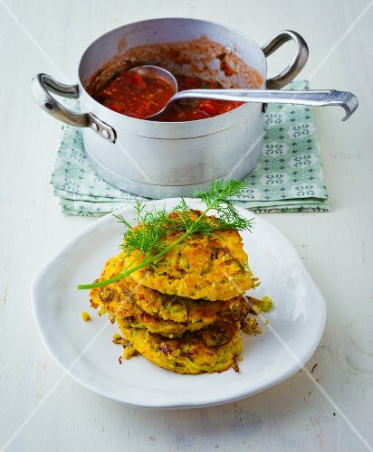 Leek and millet cakes with a fresh tomato sauce