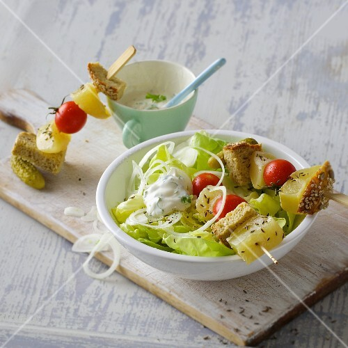Harz cheese skewers with diced bread and fresh lettuce