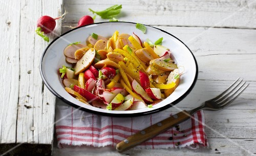 Sausage salad with radishes and peppers