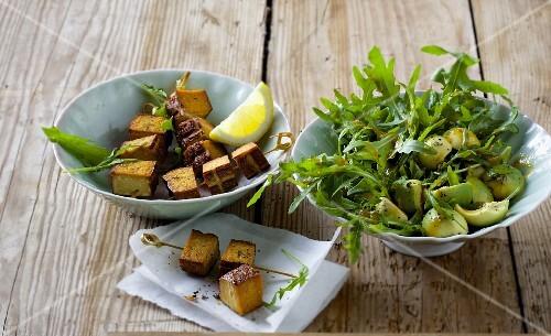 Rocket and avocado salad with smoked tofu skewers