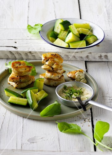 Chicken breast with sorrel cream and courgettes