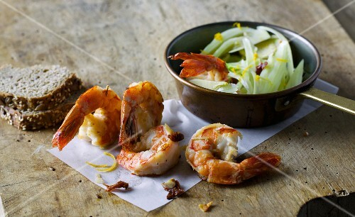 Fried king prawns with dried tomatoes and fennel