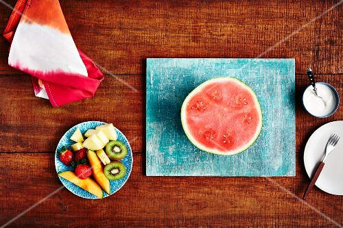 Half a watermelon and a fresh fruit salad (seen from above)