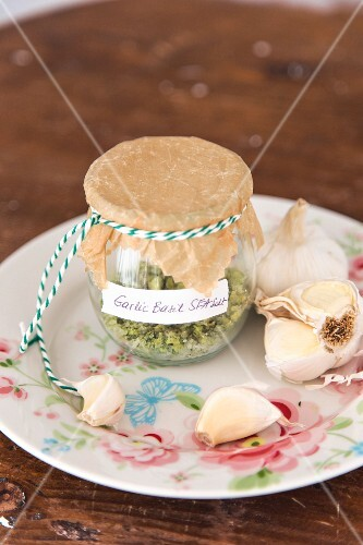 Homemade herb salad with basil and garlic in a preserving jar