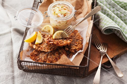 Pork escalope with a nut coating served with coleslaw