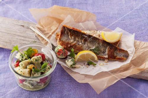 Fried trout fillets with a celery and tomato salad