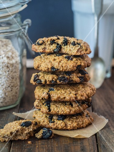 A stack of wholemeal oat cookies with raisins